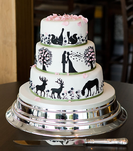 Handpainted 'New Forest Themed' Silhouette Wedding Cake, Topped with Pink Sugar Petals.